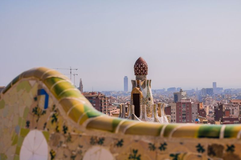 City Architecture Cityscape Building Exterior Travel Destinations Sky Built Structure Modern No People Ferris Wheel Urban Skyline Outdoors Skyscraper Day Sky And Clouds Tourist Attraction  Urban Lifestyle Tourism Barcelona City Life Full Frame Portrait Of A City Architecture Park Güell, Barcelona City