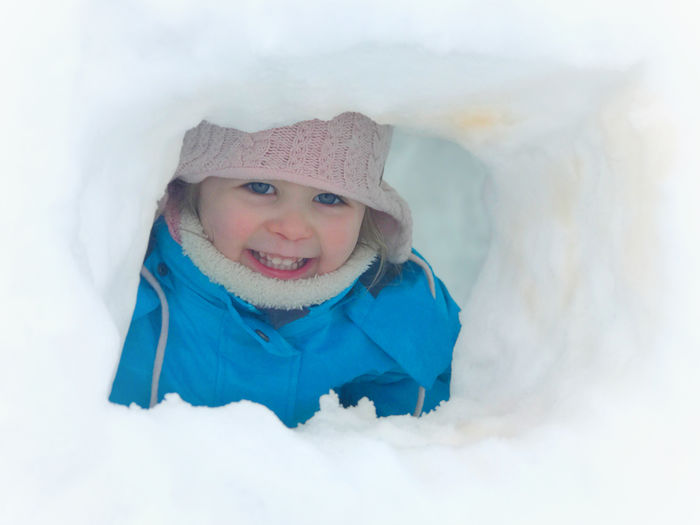 Child Childhood Clothing Cute Day Happiness Hat Igloo Innocence Knit Hat Looking At Camera Offspring One Person Outdoors Portrait Smiling Snow Warm Clothing Winter