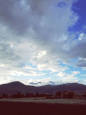 Mountain Cloud - Sky Dramatic Sky Landscape Mountain Range No People Tranquility Sky Beauty In Nature Outdoors Scenics Nature Water Day Tree Oil Pump