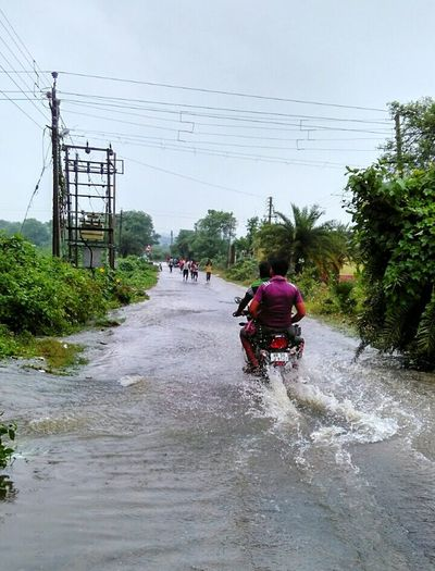 Transportation Tree Riding Outdoors Electricity Pylon Day Sky Nature People Flood Flooded Road India