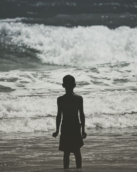 Silence. Sea Beach Water Real People Shore One Person Wave Standing Silhouette Nature Outdoors Leisure Activity Rear View Lifestyles Beauty In Nature Vacations Sand Scenics Day Horizon Over Water The Week On EyeEm
