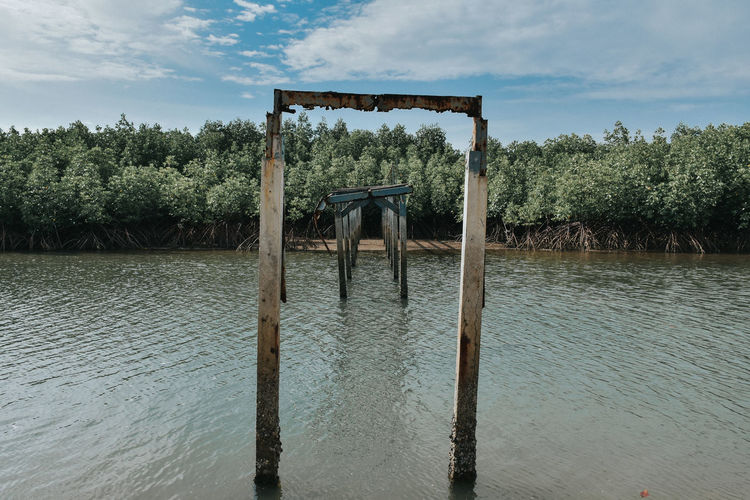 Abandoned pier in river