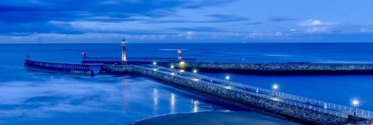 A night time long exposure of the entrance to Whitby Harbour on the North Yorkshire coast. Coastline Coastline Landscape Landscape Photography Lighthouse North Yorkshire Architecture Blue Building Exterior Cloud - Sky Coast Horizon Over Water Illuminated Landscape Lighthousephotography Long Exposure Night No People Outdoors Reflection Sea Sky Water