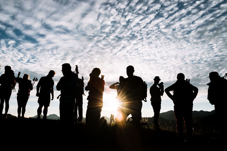 Sunrise in the Algau region of Germany- group of young adult hikers standing on a mountain during golden hour with dramatic sky Cloud - Sky Day Large Group Of People Leisure Activity Lifestyles Men Nature Outdoors People Real People Silhouette Sky Sunlight Sunset Togetherness Women