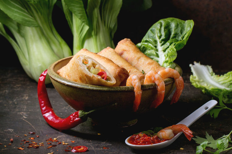 High angle view of spring rolls served in plate