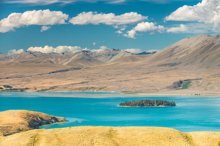 Sunny Beauty In Nature Cloud - Sky Day Environment Idyllic Lake Lake Tekapo Land Landscape Mountain Mountain Range Mountains Nature New Zealand No People Non-urban Scene Scenics - Nature Sea Sky Summer Tranquil Scene Tranquility Turquoise Colored Water