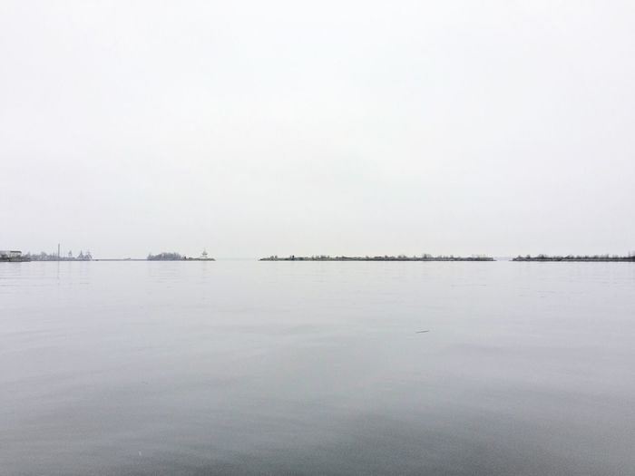Scenic view of calm sea against clear sky