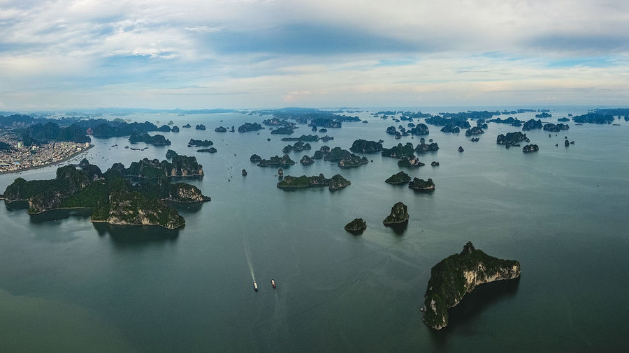 Ha Long Bay Seascape Sea And Sky Island Limestone Rocks Water Sky Cloud - Sky Nature Sea High Angle View Beauty In Nature Scenics - Nature Rock Tranquil Scene Rock - Object Waterfront Transportation Aerial View