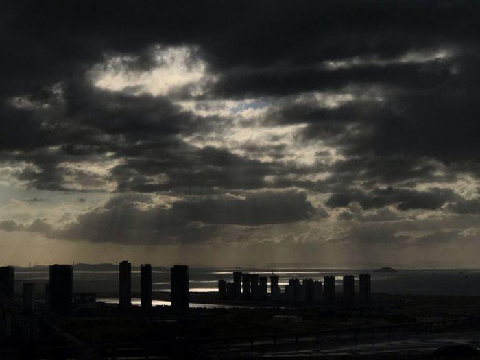 Black cloud Sky Cloud - Sky Building Exterior Built Structure Architecture Water Sea Nature City Building Beauty In Nature Sunset