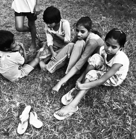 Child Kids Girls Childhood Child Field Togetherness Grass Friendship Elementary Age Full Length Sitting Real People Children Only Group Of People Outdoors People Smiling Boys Adult