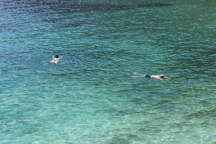 Swimming In The Sea Water Swimming Sea Floating On Water People Man Woman Summer Summertime Outdoors Day Mediterranean  Swimming In The Sea Greece Holiday Holidays Vacations Vacation Sport Acitivity Lifestyle Leisure Activity Hot Day Hot Weather