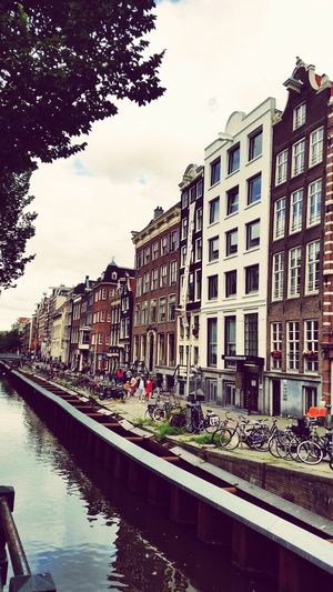Holland Amsterdam Freedom City Free Architecture Building Exterior Sky Canal Outdoors People In The Background No People Townhouse Summer Rainy Days Cityoffreedom Like4like Goodvibes Only