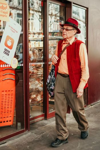 Hat One Person Clothing Standing Architecture Adult Building Exterior City Red Real People Men Full Length Lifestyles Day Street Built Structure The Art Of Street Photography