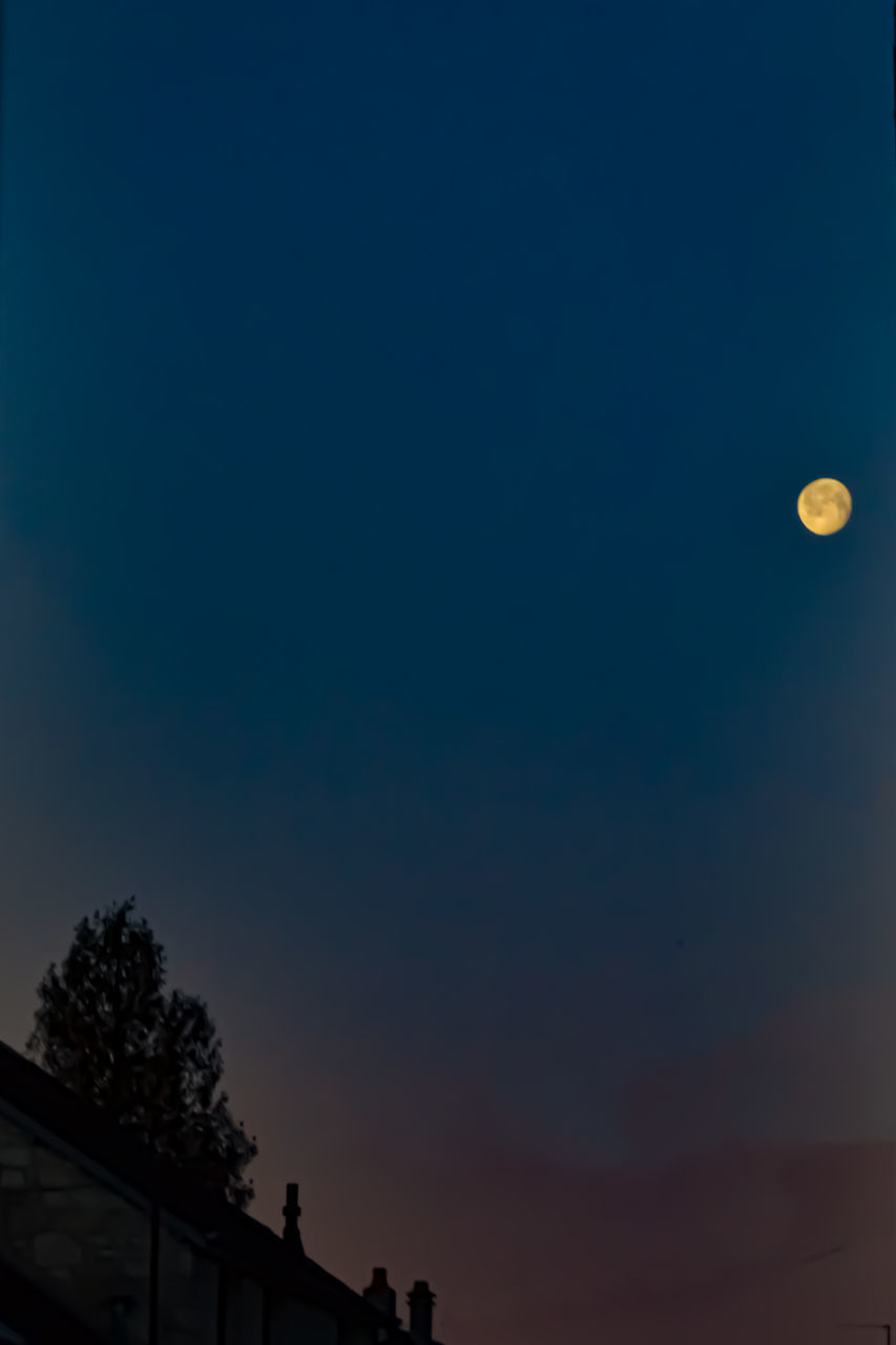 LOW ANGLE VIEW OF SILHOUETTE MOON AT NIGHT
