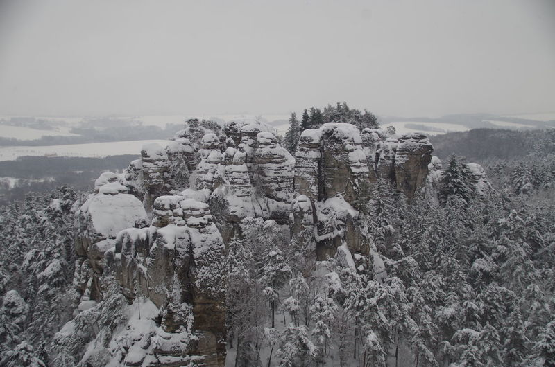 Sandstone cliffs in winter, Bohemian Paradise, Czechia Beauty In Nature Bohemian Paradise Cloudy Cold Temperature Czech Republic Czechia Day Forest Landscape Mountain Range Nature No People Outdoors Physical Geography Sandstone Cliffs Scenics Snow Snowcapped Snowcapped Mountain Tranquility Tree Winter WoodLand Woods Český Ráj