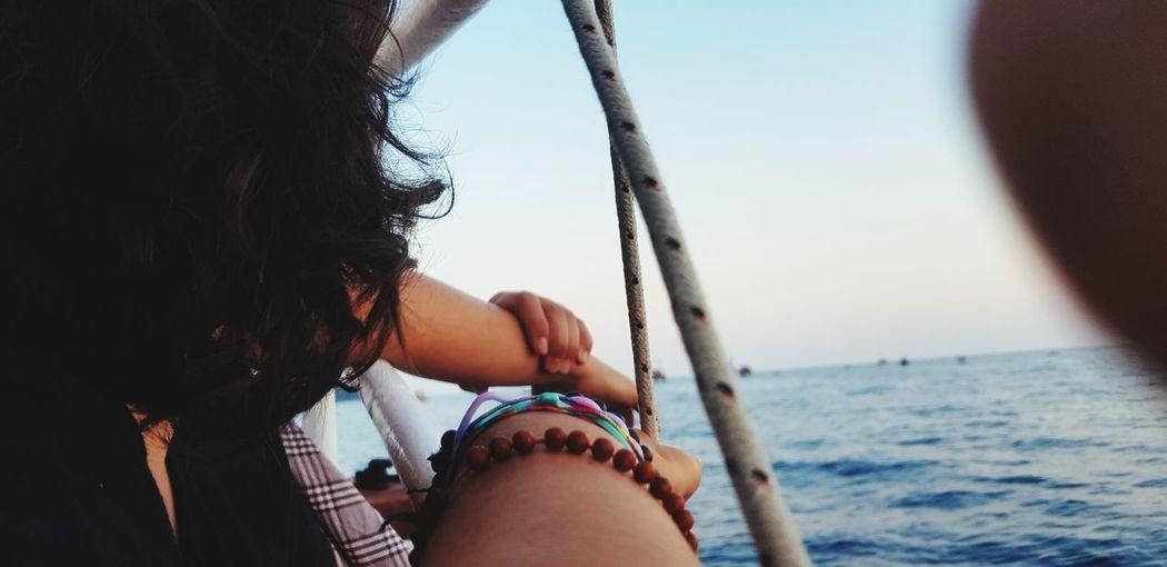 Woman in boat on sea