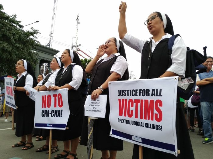 Along Commonwealth Ave. in Quezon City on July 23, 2018, protesters expressed their frustrations concerning the issues on War on Drugs, Extra Judicial Killings (EJK), Labor Contractualization, Violence Againts Women, Teachers' Salaries and Benefits by joining the rally during the 3rd State of the Nation Address (SONA 2018) of Pres. Rodrigo Duterte. EyeEm Best Shots Politics And Government Protestor Volunteer Politics Placard Protest Political Rally Democracy The Photojournalist - 2018 EyeEm Awards The Troublemakers