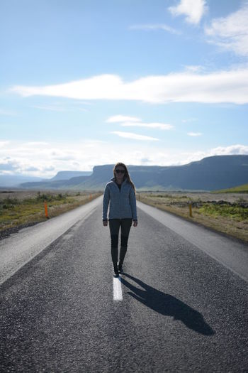 Road Full Length Front View The Way Forward One Person Mountain Casual Clothing Only Women Journey Adult Outdoors Day Asphalt Adults Only Walking People Rural Scene One Woman Only Sky Cloud - Sky Iceland Green Warm Clothing Beauty In Nature