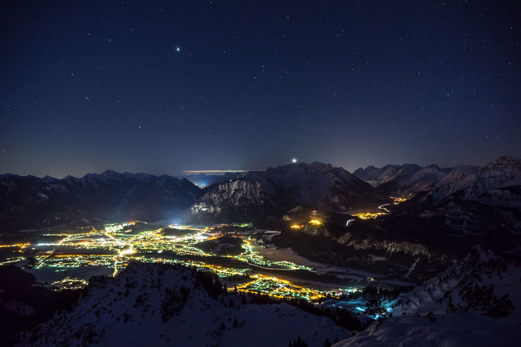 Basin of Reutte at night in winter Night Mountain Sky Snow Scenics - Nature Mountain Range Illuminated Beauty In Nature Cold Temperature Winter Star - Space Nature Space Snowcapped Mountain Astronomy No People Environment Tranquility Tranquil Scene Mountain Peak City Lights Light Winter Austria Tyrol Alps
