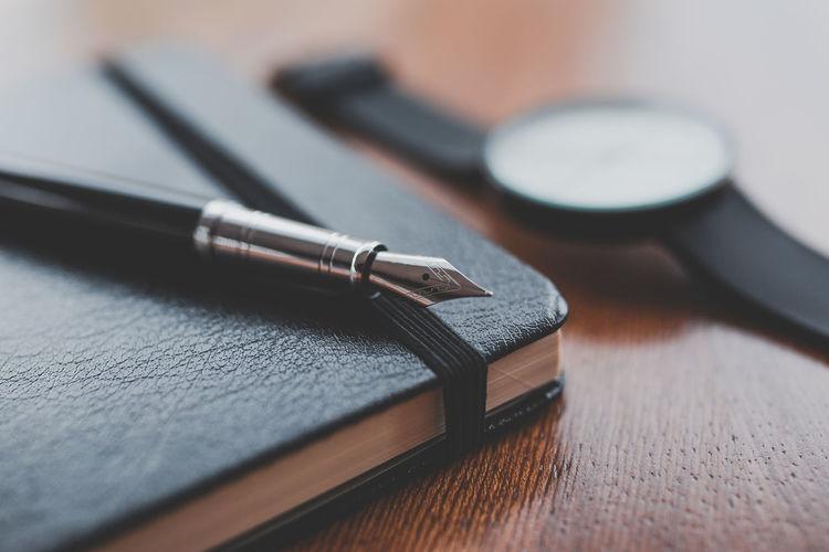 A notebook, pen