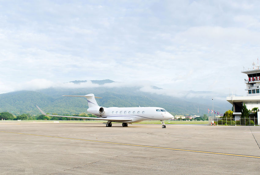 Luxury private jet in airport Aerospace Industry Air Vehicle Aircraft Wing Airplane Airport Airport Runway Arrival Cloud - Sky Commercial Airplane Corporate Jet Day Flying Luxury Mode Of Transportation Mountain Nature No People Outdoors Plane Private Airplane Public Transportation Runway Sky Transportation Travel