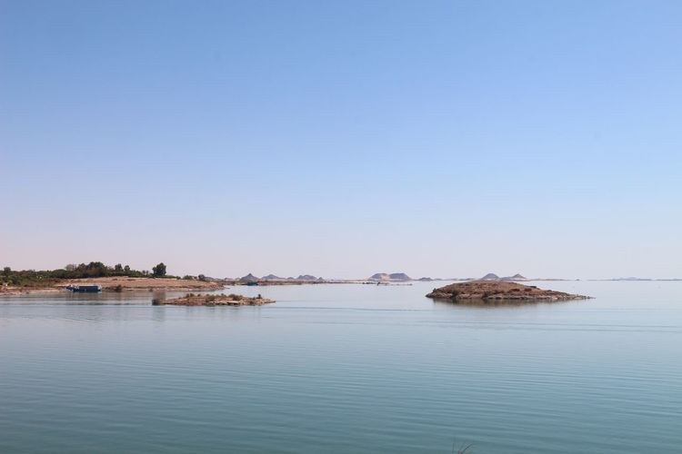 Water Blue Sea Nature Tranquility Copy Space Scenics Clear Sky Tranquil Scene Outdoors Waterfront No People Beauty In Nature Built Structure Architecture Day Beach Building Exterior Sky Nasser Lake Nasser Egypt Abu Simbel