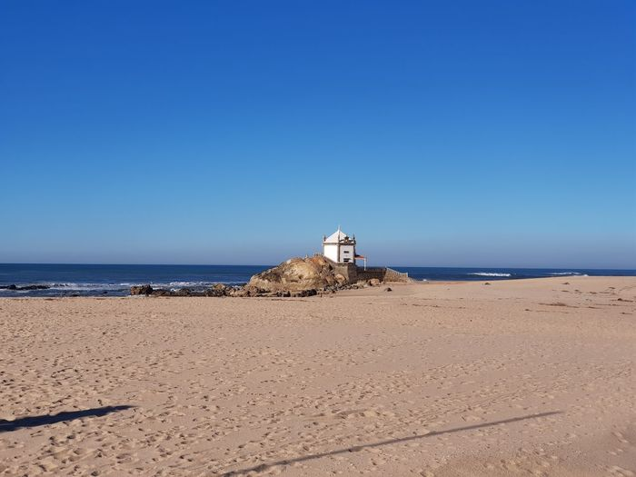 EyeEm Selects Water Clear Sky Sea Beach Sand Lighthouse Blue Wave Sunny Lifeguard