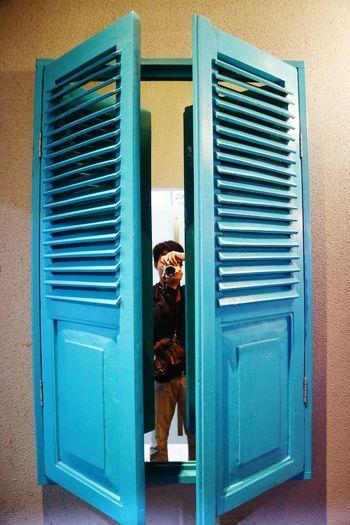 Portrait of woman with closed door