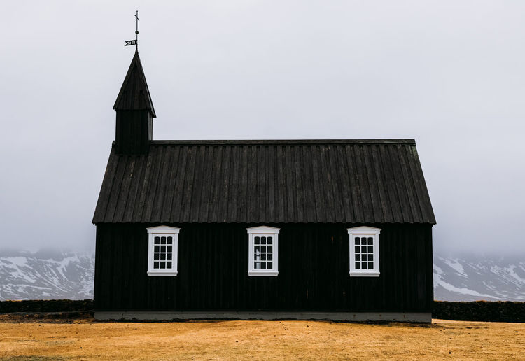 Budir Black Church Blackchurch Iceland Landscape_Collection Sigma Architecture Building Building Exterior Built Structure Canon Cloud - Sky Cottage Day House Landscape Minimalism Nature No People Old Outdoors Place Of Worship Religion Residential District Roof Sky Window The Architect - 2018 EyeEm Awards My Best Travel Photo 2018 In One Photograph