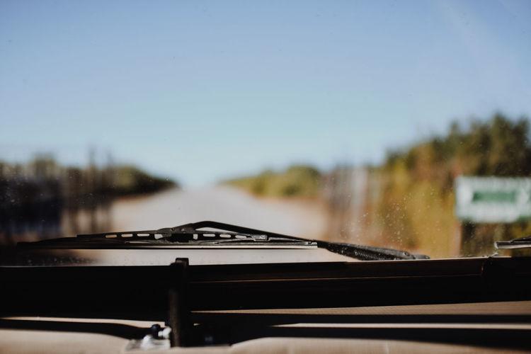 Clear sky seen through windshield of car