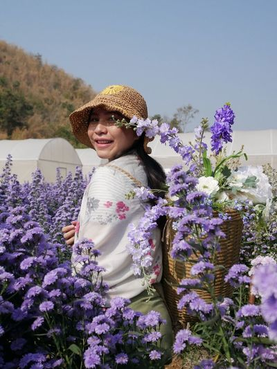 Portrait of smiling girl with purple flowers
