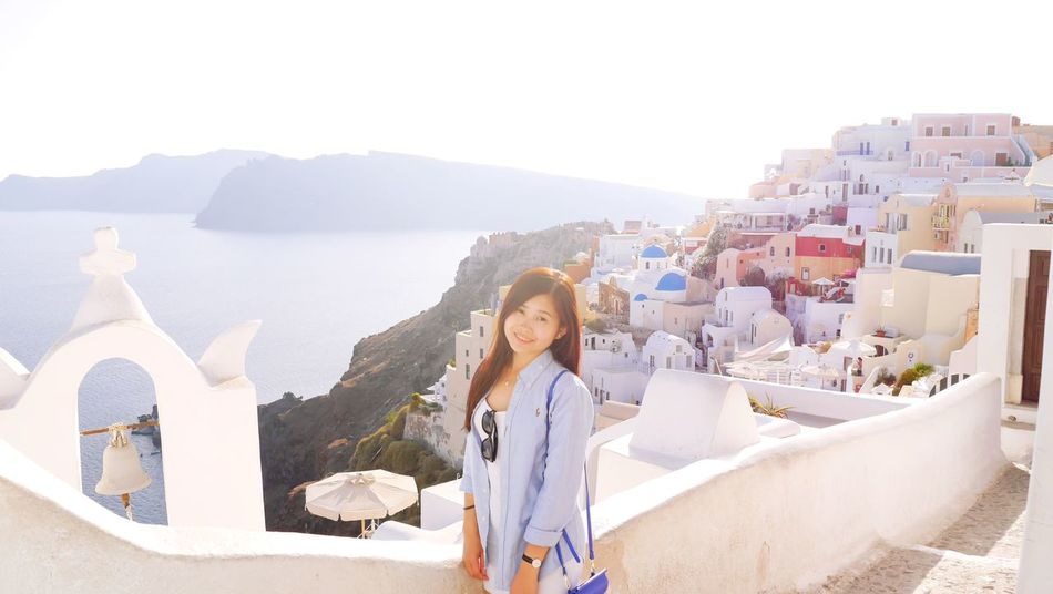 Santorini Only Women One Person Outdoors One Young Woman Only Looking At Camera Portrait Vacations Wanderlust Greece Santorini Santorini View Oia Santorini Asian  Smiling Done That.