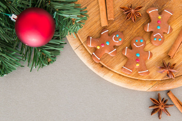 Directly above shot of gingerbread cookies and spices on table