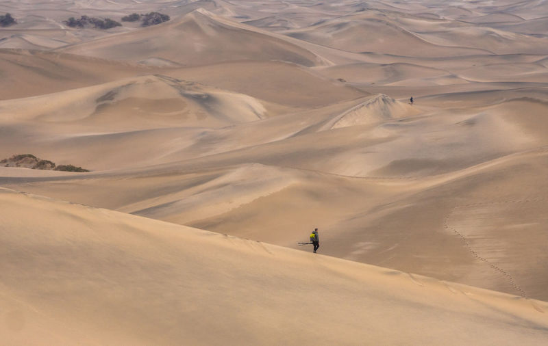 Photographers walking in the death valley desert