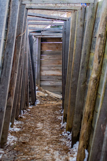 A reproduction of a world war I style trench, shot from inside. Reproduction Wood Architecture Built Structure Close-up Day Dirt No People Outdoors Replica  Structure Trench Trench Warfare War Warfare Wood - Material World War 1