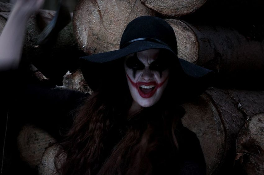 Psychotic Madness Dangerous Insanity Deep Dark Woods Darkness And Light Halloween Makeup Looking At Camera Attack We Are All Mad Here Red Lips Joker Smile Scary Zombiegirl  Jokerface You Are Next Danger Insane Scream The Joker Axe Armed Death Creepy Spooky