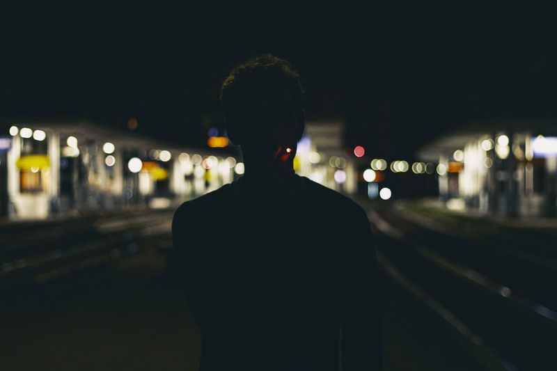One Person Illuminated Rear View Night City Focus On Foreground Track Real People Lifestyles Standing Railroad Track Architecture Transportation Rail Transportation Waist Up Leisure Activity Street Built Structure Outdoors Hairstyle #cigarette
