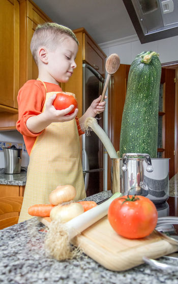Girl holding food at home