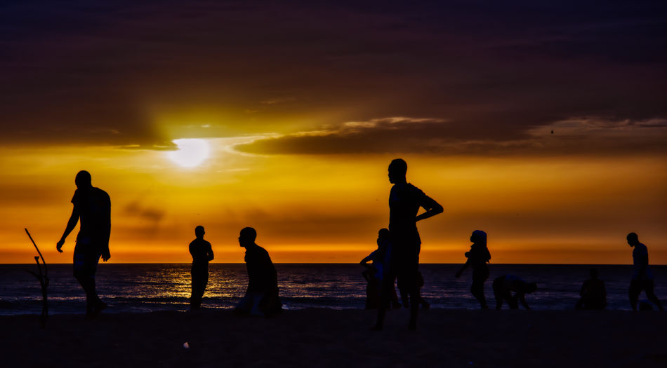 boys playing football at Sunset on the lagoon of Somone Sunset Sky Beach Group Of People Sea Silhouette Land Water Scenics - Nature Beauty In Nature Real People Orange Color Men Horizon Cloud - Sky Horizon Over Water Leisure Activity Crowd Lifestyles Outdoors Sun Soccer Sport Football