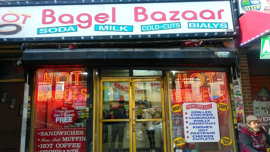 Hot Bagels. photo by Shell Sheddy Streetphotography Street Documentary Photography Shellsheddyphotography Sheshephoto The Street Photographer - 2018 EyeEm Awards The Photojournalist - 2018 EyeEm Awards City Store Communication Text Business Finance And Industry Architecture Close-up Building Exterior Built Structure Store Sign Commercial Sign Neon Fluorescent Shop Neon Colored Streetwise Photography