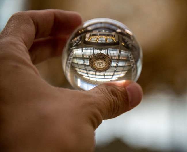 Glass Ball Photography Musée D'Orsay Accuracy Adult Body Part Circle Close-up Finger Focus On Foreground Geometric Shape Glass Reflection Hand Holding Human Body Part Human Finger Human Hand Indoors  Men One Person Positioning Selective Focus Shape Single Object
