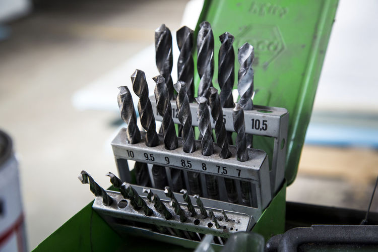 Close-up of drill bits in toolbox