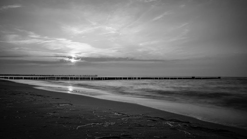 Black and White Sunset at the Baltic Sea Baltic Sea Ostsee Ostseeküste Beach Beauty In Nature Black And White Photography Blackandwhite Blackandwhite Photography Cloud - Sky Horizon Horizon Over Water Idyllic Land Nature No People Non-urban Scene Outdoors Sand Scenics - Nature Sea Sky Tranquil Scene Tranquility Water Wet