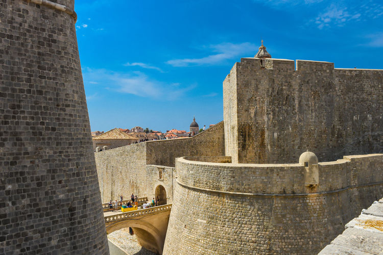 City Wall Croatia Dubrovnik, Croatia Holiday Old Town Tranquility Architecture Building Exterior Built Structure Castle City Day Dubrovnik Fort History Low Angle View Nature Outdoors Place Of Worship Sky Summer Sunlight Travel Destinations Water