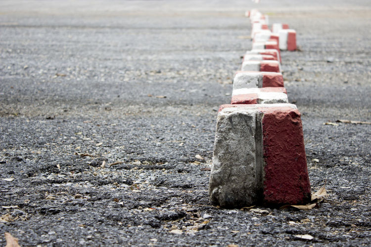 Close-up of stones on road in city