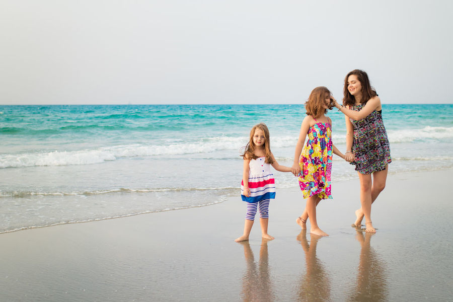 Sisters Beach Child Childhood Daughter Friendship Full Length Girls Happiness Horizon Over Water Israel Leisure Activity Outdoors Sand Sea Smiling Standing Togetherness Vacations Water