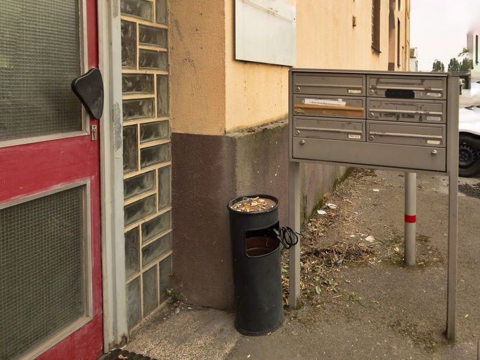 Duisburg, Germany -August 2nd 2017: House from the seventies Door No People Architecture House Flat Seventies Old Retro Typical German Seventies Glas Bricks Door Letter Box Ashtray  Lying Trash Living Settlement Ruhrgebiet Documentary