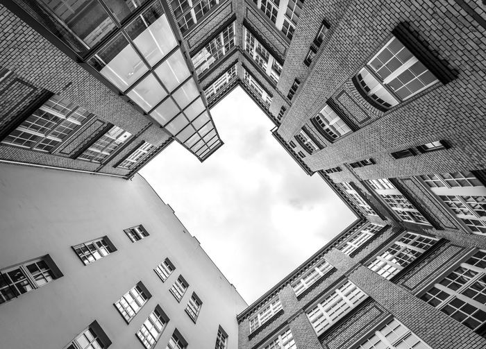 Black And White Goemetric Up View Urban Urban Geometry Architecture Built Structure Building Exterior Building Low Angle View Sky Cloud - Sky City Window No People Nature Residential District Directly Below Day Outdoors Tall - High Modern Apartment City Life Office Building Exterior Skyscraper Housing Development
