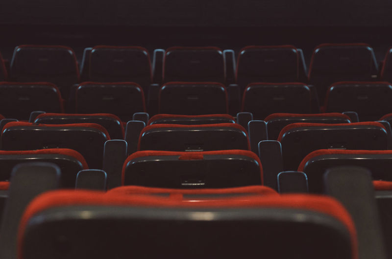 Full frame shot of empty red seats in movie theater