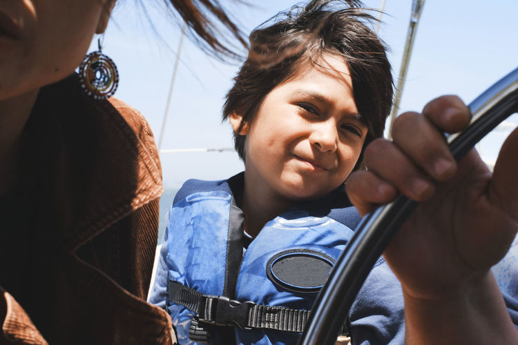 Close up on child sailing on a boat 6 Years Old Bay Berkeley Marina Boat Boys California Childhood Close-up Day Elementary Age Family Land Vehicle Leisure Activity Lifestyles Marina Mode Of Transport Ocean Outdoors Real People Sailing San Francisco Transportation USA Young Adult Let's Go. Together.